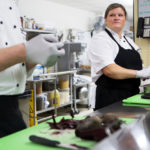 Melinda Hellum, head chef at Waldo County General Hospital, looks to Robert Coombs, kitchen supervisor at Waldo County General Hospital, while peeling a bag of fresh beets at the Waldo County General Hospital in Belfast. The kitchen staff at the hospital is working to bring the locavore, farm-to-table movement to an unusual place: the hospital cafeteria.