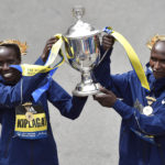 Boston Marathon women's division winner Edna Kiplagat, of Kenya, and men's division winner Geoffrey Kirui, also of Kenya, hold the trophy during the 121st Boston Marathon in Boston, Massachusetts.