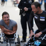 Women's wheelchair winner Manuela Schar and men's wheelchair winner Marcel Hug, both of Switzerland, congratulate each other at the finish line of the 121st Boston Marathon in Boston, Massachusetts, U.S., April 17, 2017.   REUTERS/Brian Snyder
