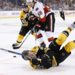 Boston Bruins left wing David Pastrnak (88) is brought down during the first period in game three of the first round of the 2017 Stanley Cup Playoffs against the Ottawa Senators at TD Garden in Boston on Monday night.