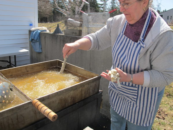 Marlene Farnsworth drops breaded smelt into the fryer at the Columbia Falls Smelt Fry on April 15.