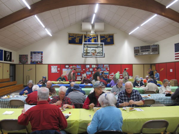 Diners enjoy a lunch of fried smelt, baked beans, cole slaw and blueberry cobbler at the annual Columbia Falls Smelt Fry on April 15.