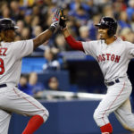 Boston's Hanley Ramirez (left) congratulates teammate Mookie Betts after Betts hit a solo home run against Toronto in the seventh inning of Tuesday's game at Rogers Centre in Toronto. John E. Sokolowski | USA TODAY Sports
