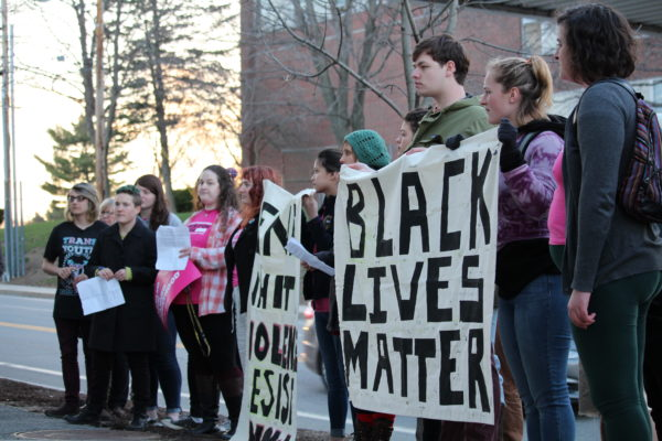 Protesters gather outside a University of Southern Maine building in Portland, where Gov. Paul LePage gave a talk.
