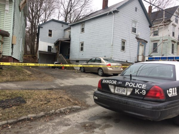 A police officer on Monday was stationed outside an apartment building on Ohio Street where a shooting took place on Sunday afternoon.
