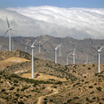 Wind turbines at the Los Angeles Department of Water and Power Pine Tree Wind Farm spin in the Tehachapi Mountains.