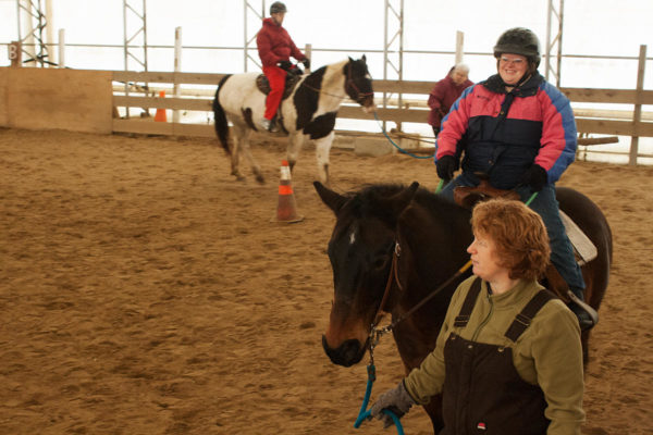 Crystal Stover, the owner and instructor at It Takes Two Farm in Windham, guides Julie Jermann on Bam in January.