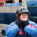 Julie Jermann removes her helmet after riding a horse named Bam at It Takes Two Farm in Windham in January.