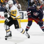 The Pittsburgh Penguins' Sidney Crosby (87) moves the puck as the Columbus Blue Jackets' Jack Johnson (7) looks on during the second period during Game 4 in the Eastern Conference quarterfinals on Tuesday, April 18, 2017, at Nationwide Arena in Columbus, Ohio.