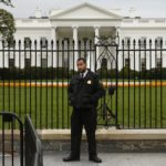 A member of the U.S. Secret Service stands guard in front of the North Lawn of the White House in Washington, Oct. 23, 2014. The Secret Service said it would no longer permit access to a sidewalk along the south fence of the White House.