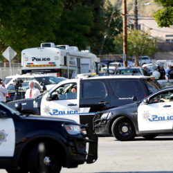 Police vehicles are pictured after a shooting at North Park Elementary School in San Bernardino, California, April 10, 2017. Police say Cedric Anderson killed his estranged wife, an 8-year-old child and then himself.