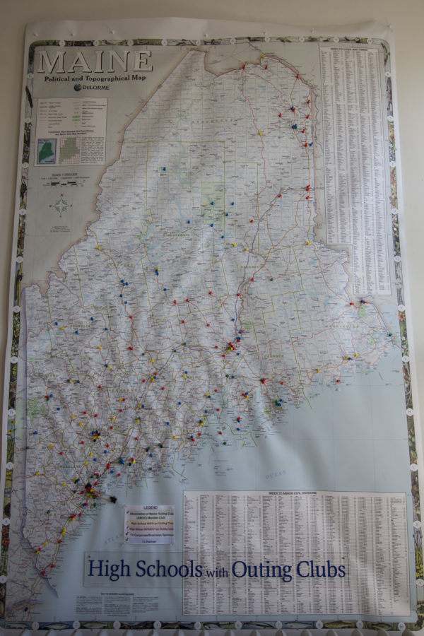 A map displaying all the high school outing clubs in Maine is posted on the wall at the Teens To Trails office in downtown Brunswick. Each pin on the map represents an outing club. Teens To Trails is a nonprofit organization with the mission to support high school outing clubs in Maine and get more outing clubs up and running, with the intent to get more teens active outdoors.