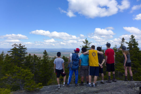 Maine outing club students pause to take in a view while hiking Pleasant Pond Mountain during the 2016 Teens To Trails Spring Thing, a weekend-long camping event for students to learn outdoor skills and network with other outing club students. Teens To Trails -- also known as T3 -- is a nonprofit organization that helps high school outing clubs throughout Maine through networking, training and grants.