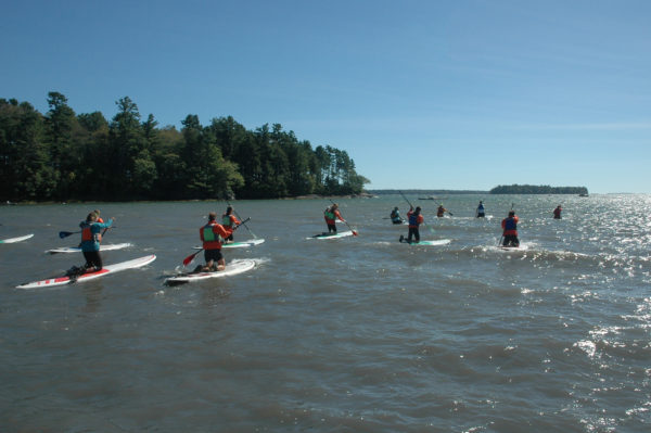 Students from outing clubs throughout Maine learn how to use a stand up paddle board in September of 2016 at the Association of Maine Outing Clubs Conference in Freeport. AMOC is a network of Maine outing clubs created by Teens to Trails, a nonprofit organization that helps high school outing clubs throughout Maine through networking, training and grants.