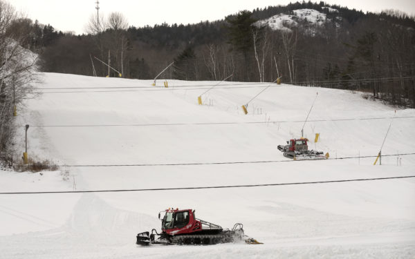 Groomers roll across the slopes at Camden Snow Bowl.