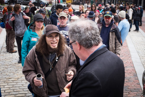 Robert Chute (right) and a man who only gave his name as Michael L. light up a large joint in Portland's Monument Square on Thursday afternoon, 4/20. The weed was a gift to the crowd from legalization activist Crash Berry who also handed out free copies of his latest book &quotMarijuana Valley.&quot
