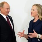 U.S. Secretary of State Hillary Clinton talks with Russian President Vladimir Putin during the arrival ceremony for the Asia-Pacific Economic Cooperation Summit in Vladivostok, Russia on September 8, 2012.