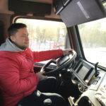 Justin Paulin learns how to drive a tractor trailer truck.