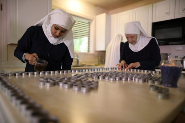 California &quotweed nun&quot Christine Meeusen, 57, who goes by the name Sister Kate (R), and Desiree Calderon, who goes by the name Sister Freya, pour CBD salve made from hemp at Sisters of the Valley near Merced, California, U.S., April 18, 2017.