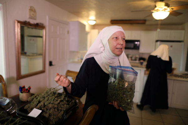 California &quotweed nun&quot Christine Meeusen, 57, who goes by the name Sister Kate, holds hemp in the kitchen at Sisters of the Valley near Merced, California, U.S., April 18, 2017.