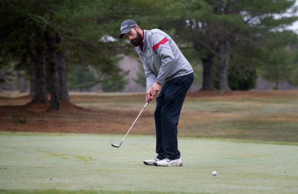 "Despite the weather, Greg Taylor of Hampden spent Friday morning at Hermon Meadow Golf Course. ""It's not the best day,"" said Taylor, ""but golfers are passionate so somebody will always be out there."""