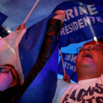 Supporters of Marine Le Pen, French National Front political party leader and candidate for French 2017 presidential election, react after early results in the first round of 2017 French presidential election, in Henin-Beaumont, northern France, April 23, 2017.