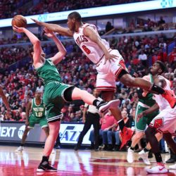 Boston's Kelly Olynyk (left) shoots as Chicago's Cristiano Felicio (6) defends during the first half of Game 4 of the first round of the 2017 NBA Playoffs at United Center in Chicago on Sunday.