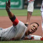 Boston's Xander Bogaerts slides safety into third base after a first inning hit by teammate Andrew Benintendi during Sunday's game against Baltimore at Oriole Park at Camden Yards.