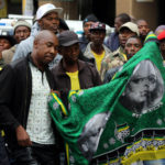 Supporters of South Africa's President Jacob Zuma gather outside the headquarters of the ruling African National Congress party, in Johannesburg, South Africa, April 7, 2017.