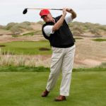 Donald Trump practices his swing at the 13th tee of his new Trump International Golf Links course on the Menie Estate near Aberdeen, Scotland, Britain June 20, 2011.