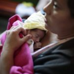 "Alba Albisurez hugs her baby, who was born at 7 months, during the ""Kangaroo Mothers"" program in the maternity ward of the Roosevelt hospital in Guatemala City October 29, 2012. The 19-day program, known as ""Madres Canguro"", is a method where mothers are trained to breastfeed and hold their premature babies near their chest as the body-to-body contact reduces infant mortality in preterm infants."