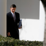 White House National Security Adviser Michael Flynn walks down the White House colonnade on the way to Japanese Prime Minister Shinzo Abe and President Donald Trump's joint news conference at the White House in Washington, Feb. 10, 2017.