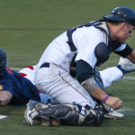 Post 51's Zach Mathiev (left) avoids the tag at home past Comrades' Sam Huston during their American Legion baseball tournament game in July 2015 at Husson University in Bangor.