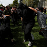 Conservative demonstrators and protesters against U.S. President Donald Trump fight during a Patriots Day Free Speech Rally in Berkeley, California, U.S., April 15, 2017.