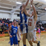 Lawrence's Mason Cooper (center) blocks a shot from Brewer's Danny Davis (right) in a 2015 file photo.
