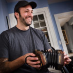 "PORTLAND, MAINE -- 04/18/17 -- Christian ""Junior"" Stevens, 32, plays Irish-style concertina with his student Tim Ebersold in Portland on Tuesday. The Maine Arts Commission named Stevens a master of his art and awarded Ebersold a traditional arts apprenticeship grant to study concertina with him. Troy R. Bennett 
