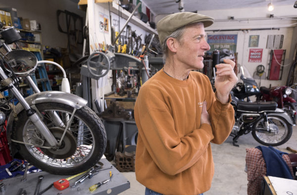 Chuck Sim, 60, of Winterport in his shop where he rebuilds antique motorcycles. Sim specializes in Moto Guzzi bikes, but he has worked on many antique cars and bikes over the years.