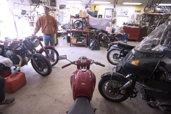 Chuck Sim, 60, of Winterport in his shop where he rebuilds antique motorcycles. Sim specializes in Moto Guzzi bikes but has worked on many antique cars and bikes over the years.