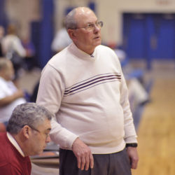 Longtime Bangor High School assistant coach Joe Nelson (left), pictured on the bench alongside boys basketball coach Roger Reed in 2011, has been hired as the head coach of the Rams' girls basketball program.