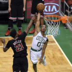Chicago's Jimmy Butler (left) tries to block the shot of Boston guard Avery Bradley during the second half of Wednesday's first-round NBA playoffs game at TD Garden in Boston.