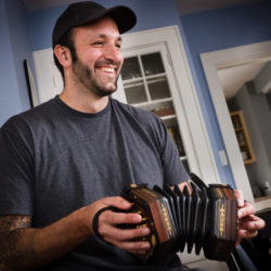 Christian &quotJunior&quot Stevens, 32, plays Irish-style concertina with his student Tim Ebersold in Portland. The Maine Arts Commission named Stevens a master of his art and awarded Ebersold a traditional arts apprenticeship grant to study concertina with him.