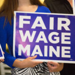 Local business owners back the minimum wage referendum during a press conference in Bangor, June 7, 2016.
