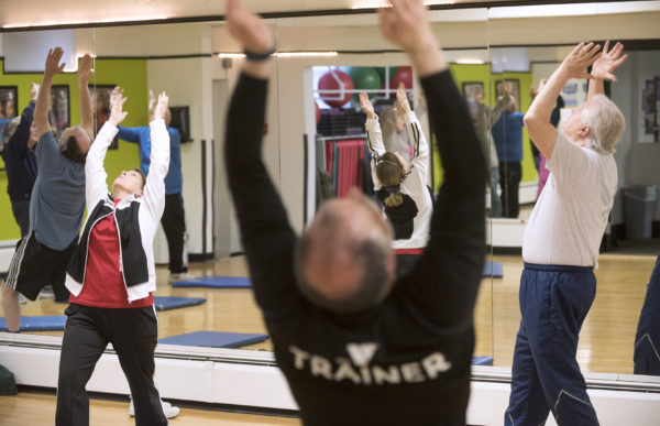 Greg Zielinski (center) leads a yoga class for seniors at the Bangor Y Wednesday morning. Also pictured are Gretchen Dyer-Gagnon (left) and Rick Alexander.