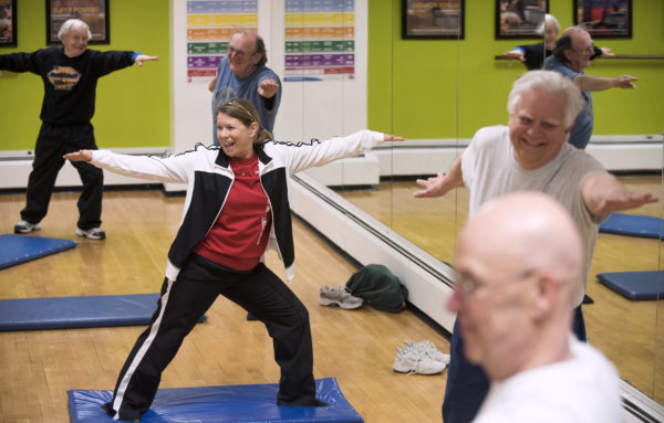 People participate in a yoga class for seniors at the Bangor Y on Wednesday morning.