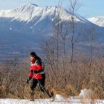 A cross-country skier passes Mount Katahdin while on a trail in the Katahdin Woods and Waters National Monument in February.
