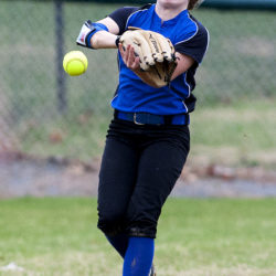 Hermon's Laura Zenk misjudges a fly ball from Old Town during their softball game in Old Town Thursday.