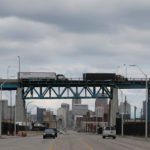 Semi trucks headed towards Windsor, Ontario, drive on the Ambassador bridge in Detroit, Michigan, U.S., April 26, 2017.