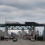 Semi trucks headed towards Windsor, Ontario, drive on the Ambassador bridge in Detroit, Michigan, U.S., April 26, 2017.