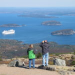 Two people stop to look out at Frenchman Bay near the top of Cadillac Mountain in Acadia National Park on Saturday, Oct. 19, 2013, two days after the park reopened following a 16-day shutdown of federal government.