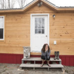 Mary Leaming sits in the front of her tiny home that is nearly complete. Leaming said she had relatively difficult time to secure a small loan to pay for a parcel of land in Unity and an Amish-built tiny house. She finally was able to get financing through a credit union and now her new home is nearly complete.